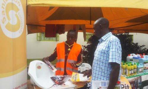 Fresh Pit's James Wangwa explains to a visitor about latrine emptying using the gulper method at the 2019 UMA trade fair. SSG PHOTO