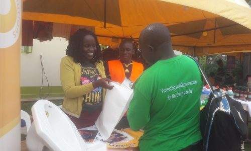 The Sanitation Solutions Group Client Relations Officer Ms Phionah Opoka interacts with a visitor.